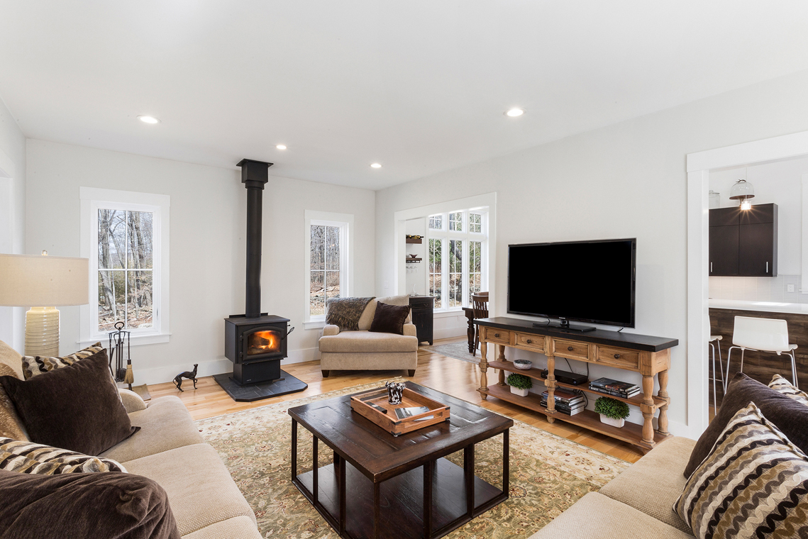 02 15 Guinea Hollow Road Tewksbury Township — living room with wood stove